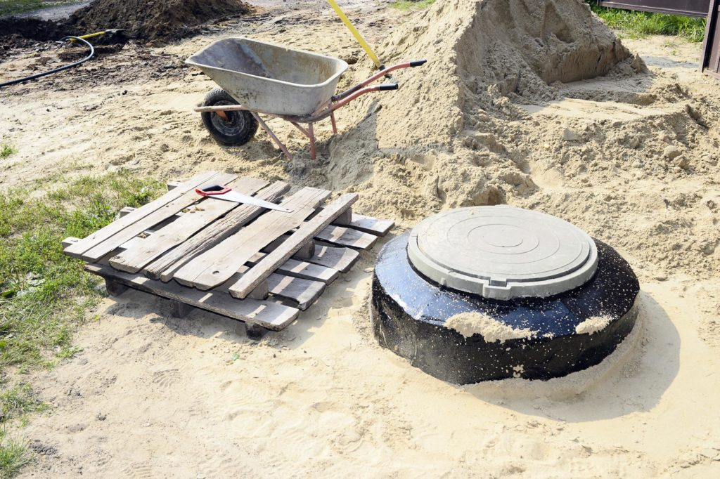 a septic tank and a pile of sand